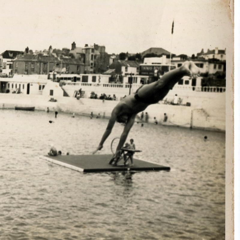 Mike Thomas diving into Jubilee Pool