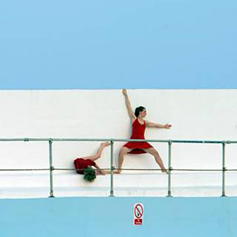 Live art at the pool - red performers