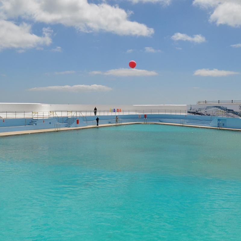 Balloon rises above the pool at Art75