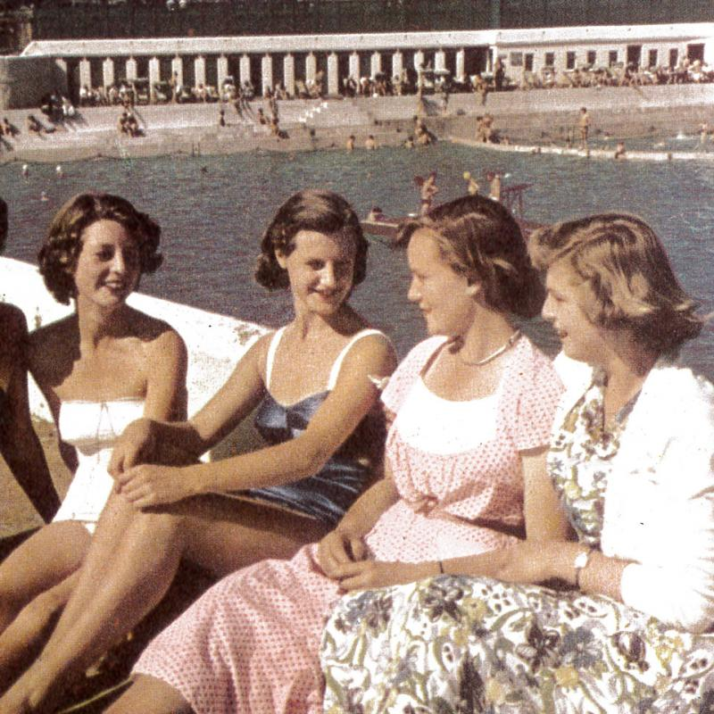 Young women pose for the camera on the top terrace