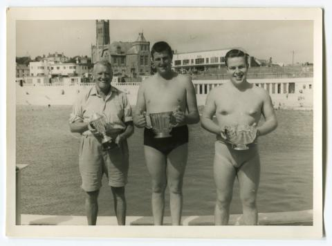 Three Cornwall County cups with swimming coach