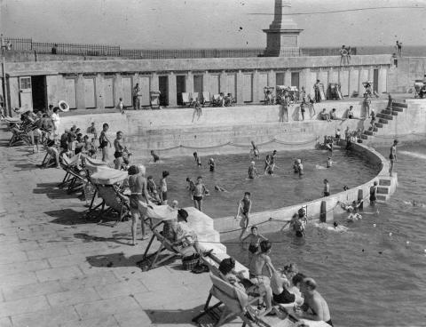 Children's pool, people in deck chairs